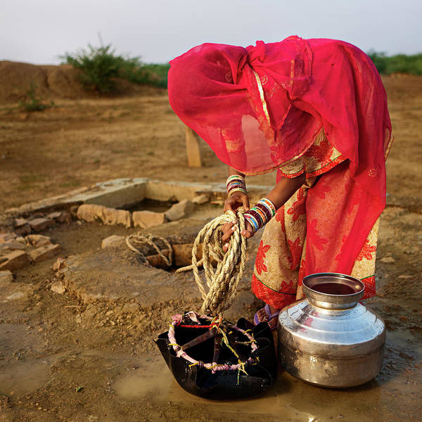 Working Art Print featuring the photograph Indian Woman Getting Water From The by Hadynyah