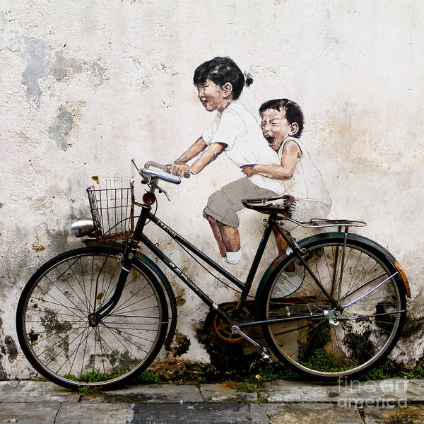 Little Children On A Bicycle Art Print featuring the photograph Little Children on a Bicycle by Donald Chen