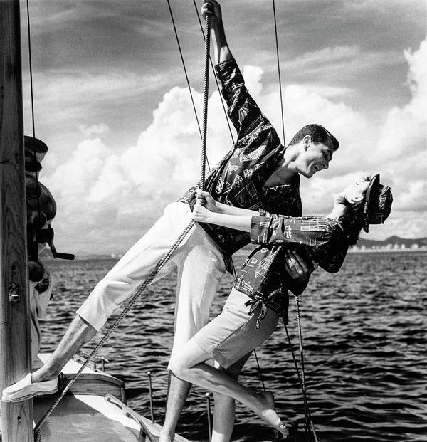 Outdoors Art Print featuring the photograph Models Wearing A Bennett Shirts On A Sailboat by Richard Waite