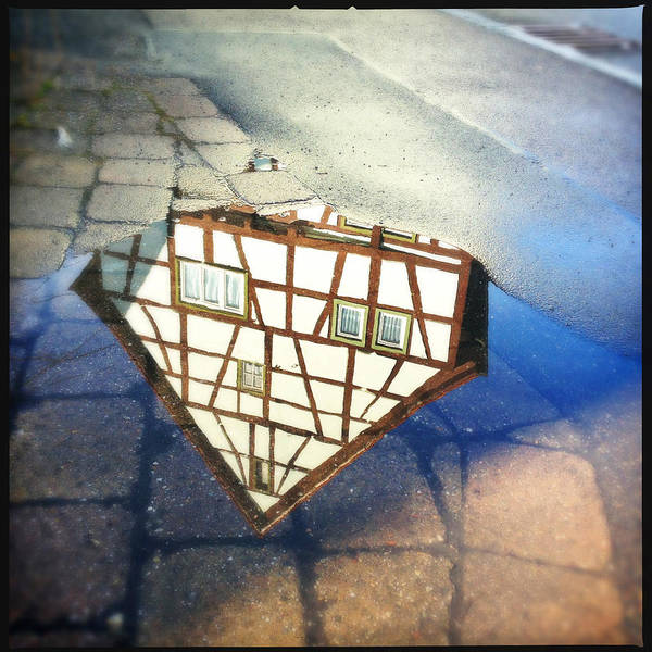 Reflection Art Print featuring the photograph Old half-timber house upside down - water reflection by Matthias Hauser