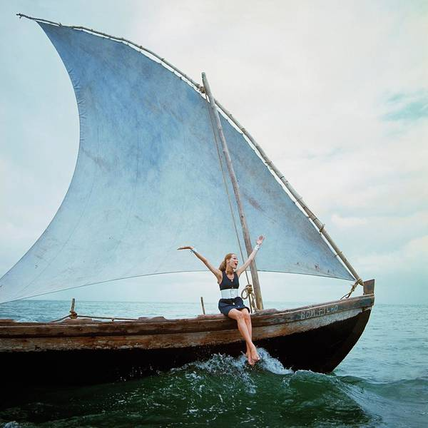 Boat Art Print featuring the photograph Veruschka Von Lehndorff Sitting On Edge by Franco Rubartelli
