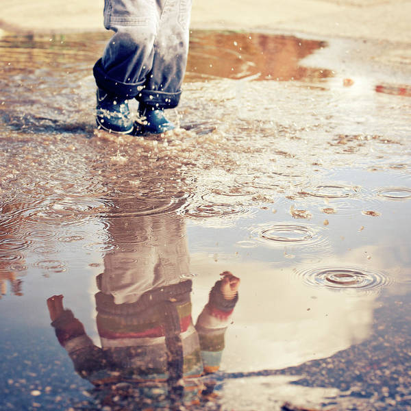 Toddler Art Print featuring the photograph Child In A Puddle by Vpopovic