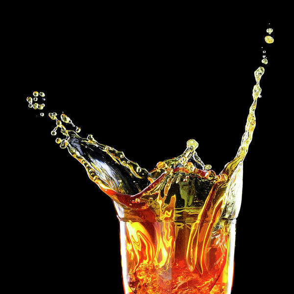 Alcohol Art Print featuring the photograph Cocktail With Big Splash In A Tumbler by Chris Stein