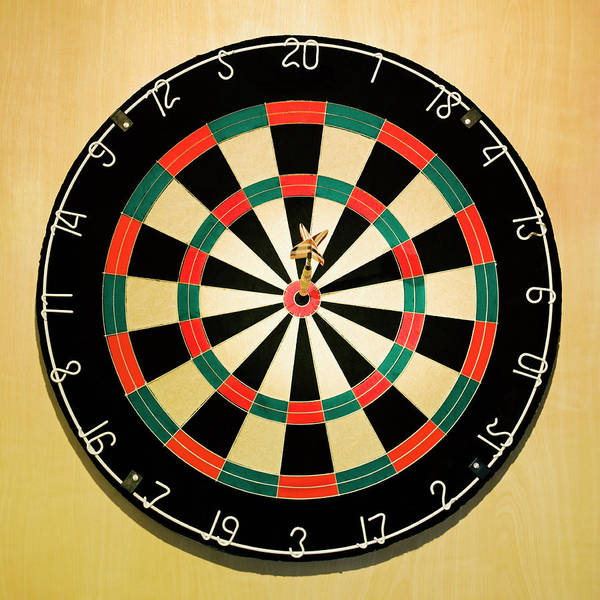 Expertise Art Print featuring the photograph Dart In Bulls Eye On Dart Board by Fuse