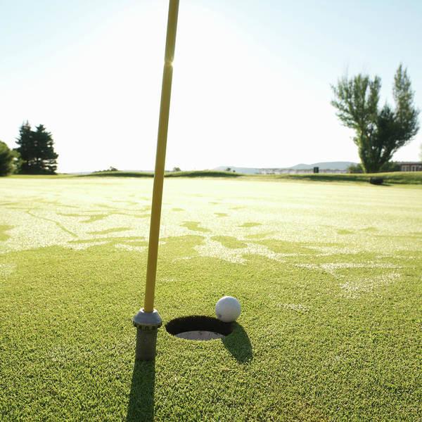 Grass Art Print featuring the photograph Golf Ball Near Hole At Sunrise, High by Ascent/pks Media Inc.