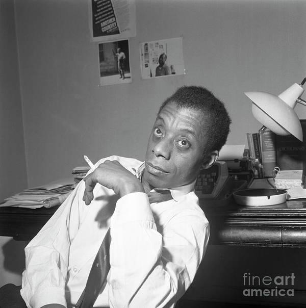 Smoking Art Print featuring the photograph James Baldwin Sitting Smoking by Bettmann
