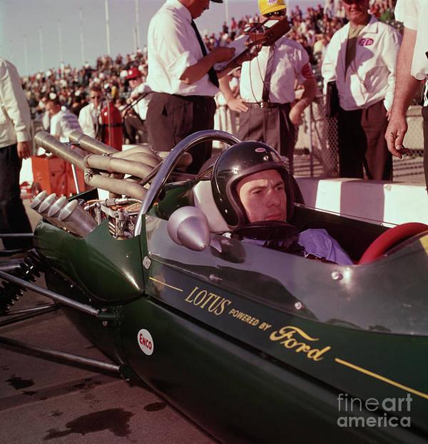 Crash Helmet Art Print featuring the photograph Jim Clark In His Ford Lotus by Bettmann