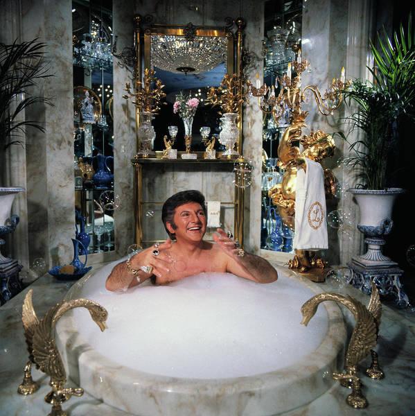 Mature Adult Art Print featuring the photograph Liberace Taking A Bubble Bath by Bettmann
