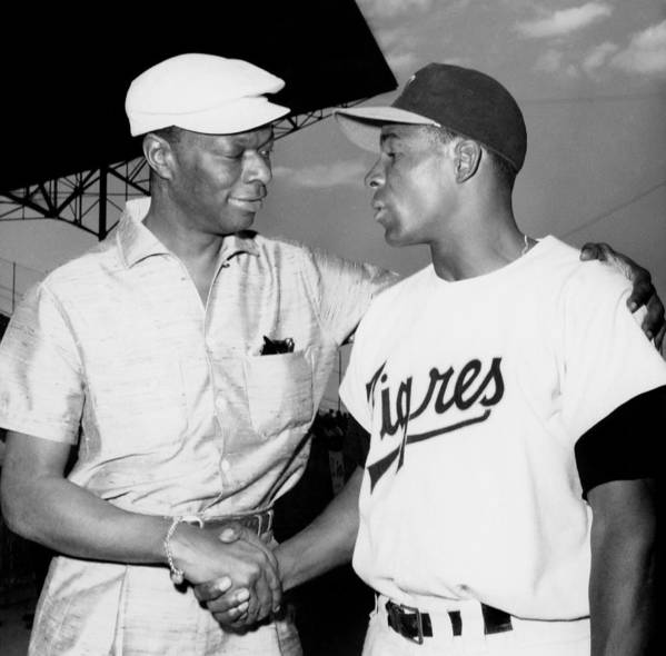1950-1959 Art Print featuring the photograph Nat King Cole And Minnie Minoso by Michael Ochs Archives