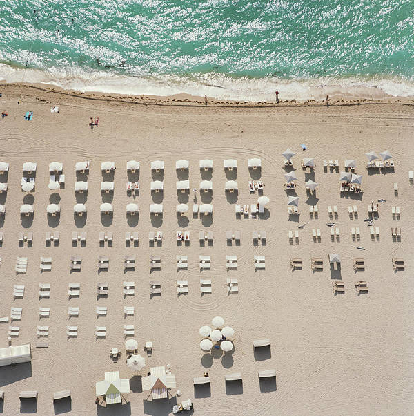 Water's Edge Art Print featuring the photograph People At Beach, Using Rows Of Beach by John Humble