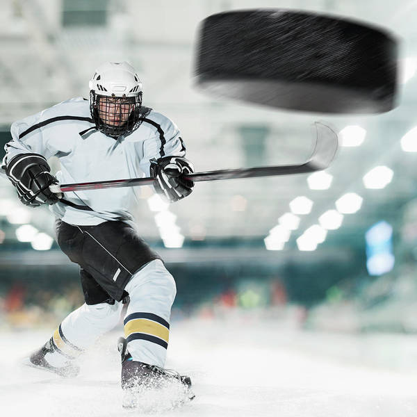 People Art Print featuring the photograph Puck Shot By Ice Hockey Player by Bernhard Lang