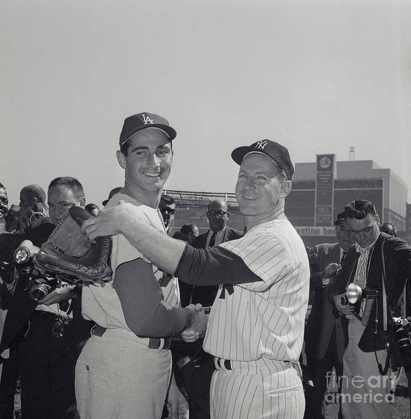 Sandy Koufax Art Print featuring the photograph Sandy Koufax And Whitey Ford Shaking by Bettmann