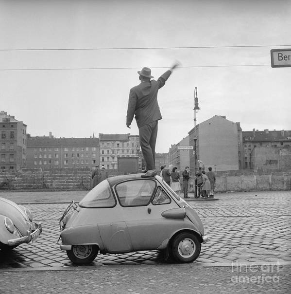 Cold War Art Print featuring the photograph West Berliner Waving To East Berliners by Bettmann