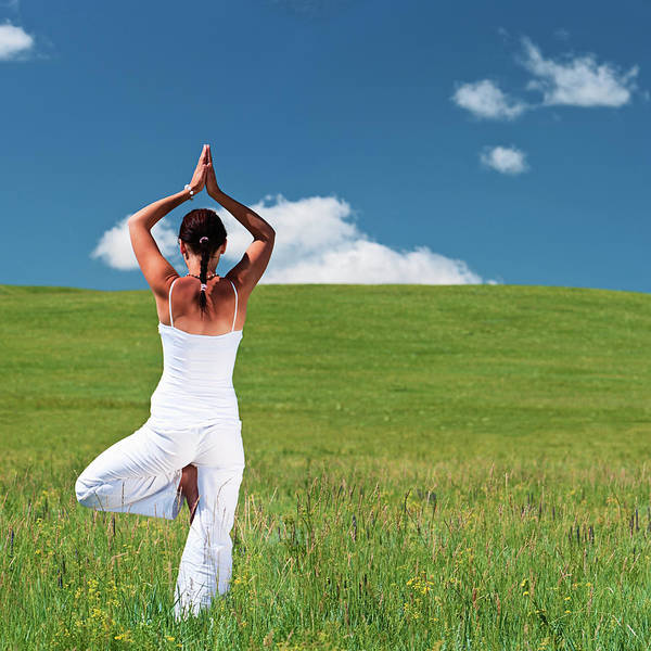 Scenics Art Print featuring the photograph Young Woman Practicing Yoga by Hadynyah