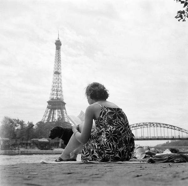 Sunbathing Art Print featuring the photograph Young Woman Taking In The Sun On The by Keystone-france