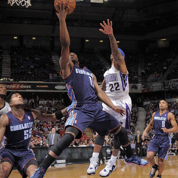 Kemba Walker Art Print featuring the photograph Kemba Walker and Isaiah Thomas by Rocky Widner