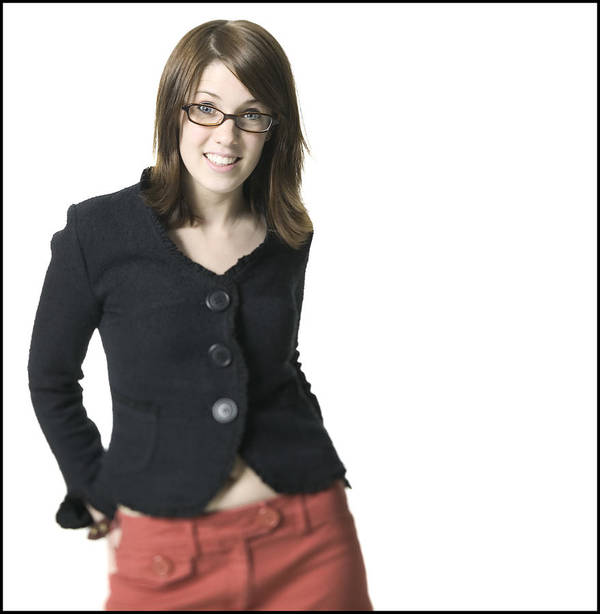 White Background Art Print featuring the photograph Medium Shot Of A Young Adult Female In A Black Shirt And Glasses As She Smiles by Photodisc