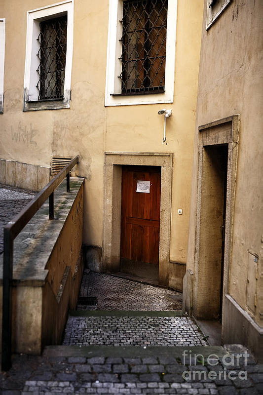 Down The Stairs In Praha Art Print featuring the photograph Down The Stairs In Praha by John Rizzuto