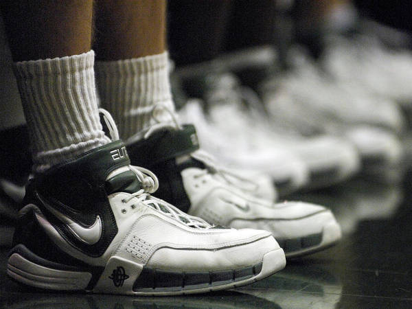 Vermont Basketball Print featuring the photograph Basketball Shoes In A Row by Replay Photos