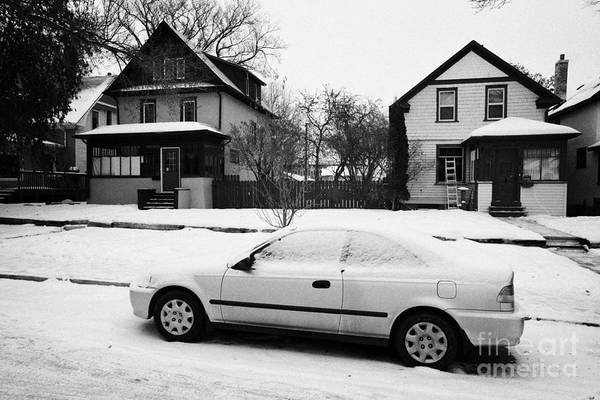 Snow Print featuring the photograph car covered in snow parked by the side of the street in front of residential homes caswell hill Sask by Joe Fox