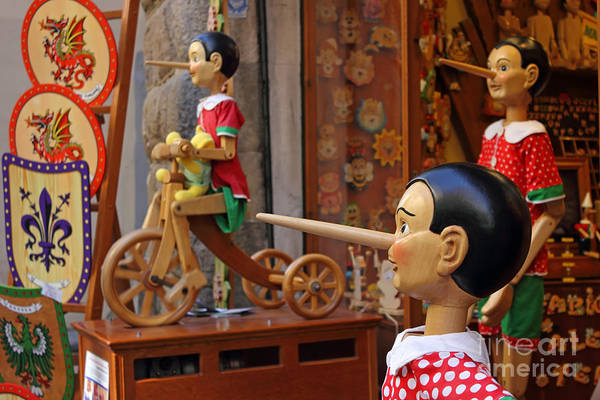 Marionette Print featuring the photograph Pinocchio Inviting Tourists In Souvenirs Shop by Kiril Stanchev