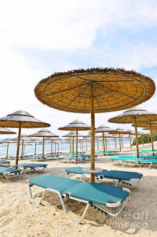 Beach Print featuring the photograph Beach Umbrellas And Chairs On Sandy Seashore by Elena Elisseeva