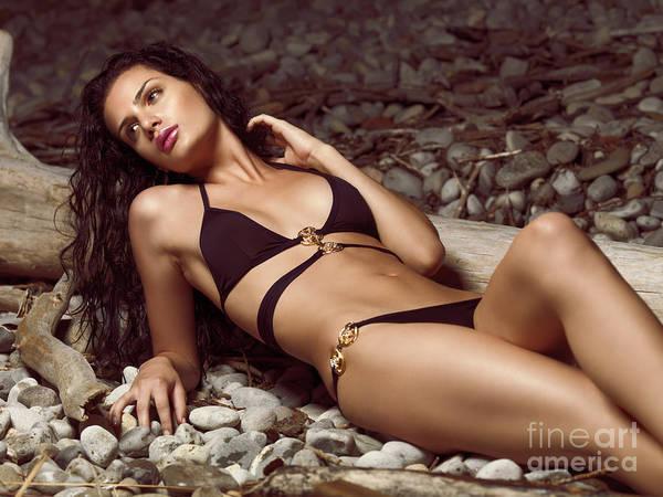 Bikini Print featuring the photograph Beautiful Young Woman In Black Bikini On A Pebble Beach by Oleksiy Maksymenko