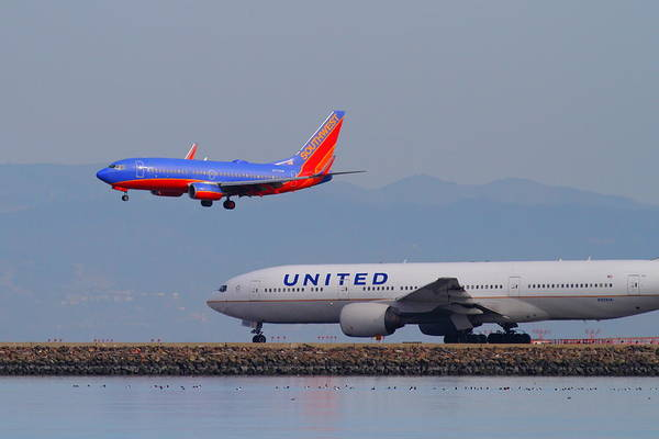 Southwest Print featuring the photograph United Airlines And Southwest Airlines Jet Airplane At San Francisco International Airport Sfo.12087 by Wingsdomain Art and Photography