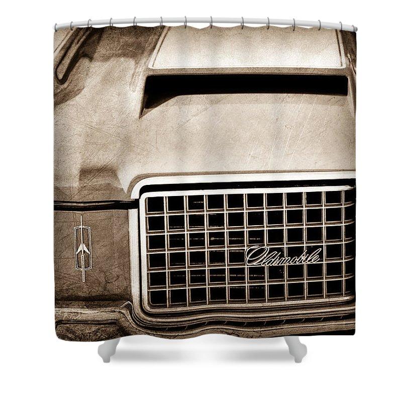 1972 Oldsmobile Grille Emblem Shower Curtain featuring the photograph 1972 Oldsmobile Grille Emblem by Jill Reger