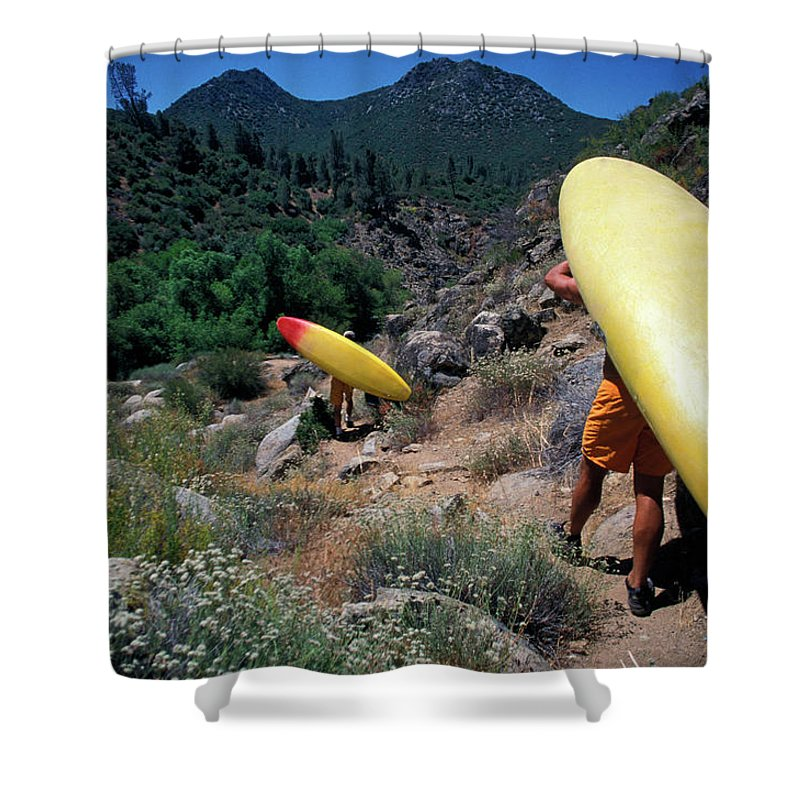 Action Shower Curtain featuring the photograph A Couple Carries Their Kayaks by Corey Rich