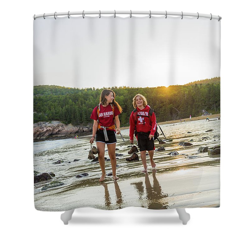 Sunlight Shower Curtain Featuring The Photograph A Teenage Boy And Girl Walk On Sand By Jerry