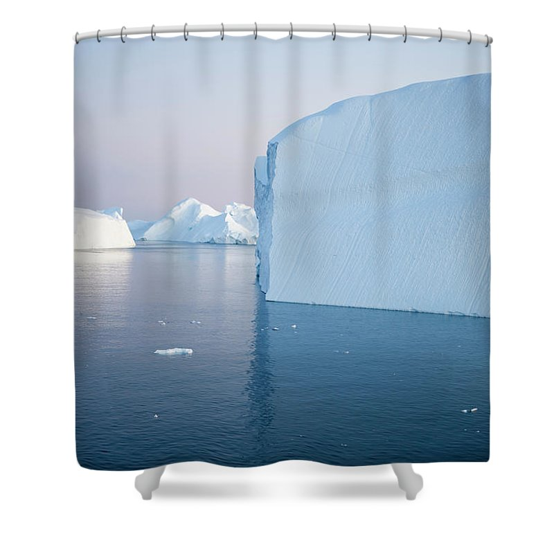 Melting Shower Curtain featuring the photograph Icebergs Of Ilulissat Kangerlua by Holger Leue