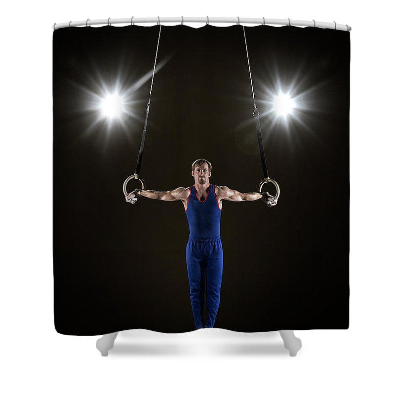 Focus Shower Curtain featuring the photograph Male Gymnast On Rings by Mike Harrington