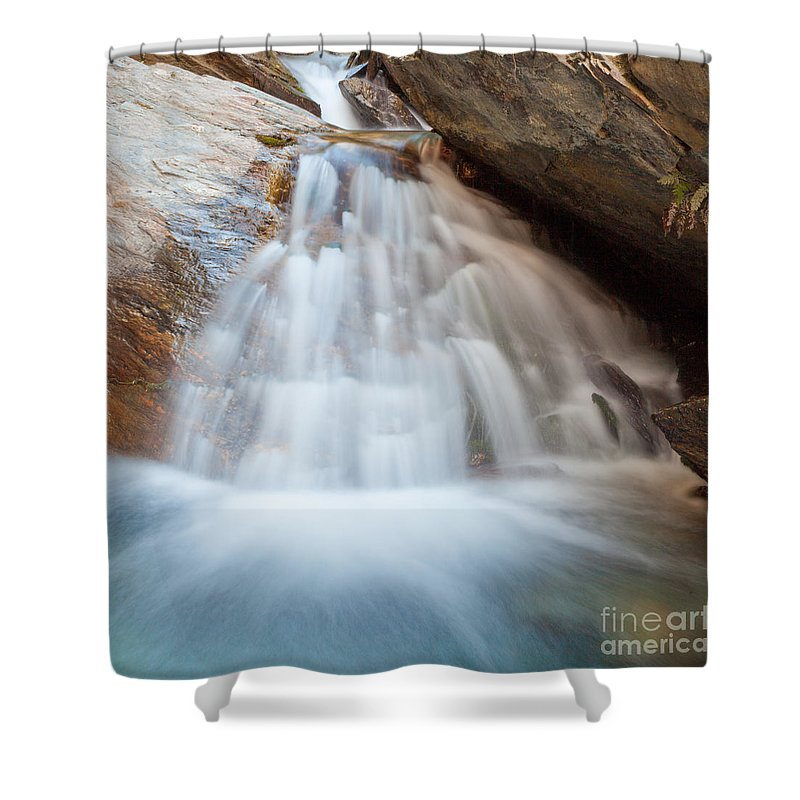 Cascade Shower Curtain featuring the photograph Small Waterfall Casdcading Over Rocks In Blue Pond by Stephan Pietzko