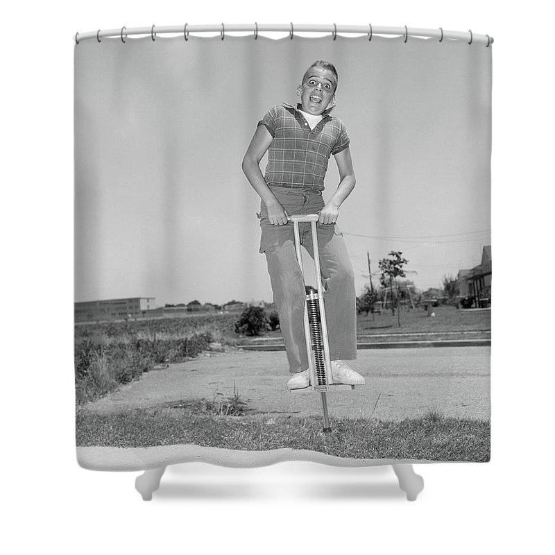 Photography Shower Curtain Featuring The Photograph 1950s Boy Jumping On Pogo Stick Funny By Vintage Images