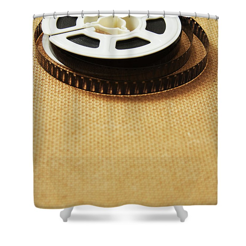 The Media Shower Curtain featuring the photograph A Reel, Or Spool, Of 8mm Movie Film by Jon Schulte