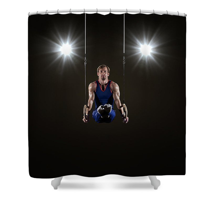 Expertise Shower Curtain featuring the photograph Male Gymnast On Rings by Mike Harrington