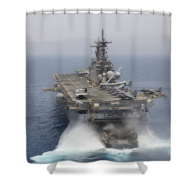 Military Shower Curtain featuring the photograph A Landing Craft Air Cushion Enters by Stocktrek Images