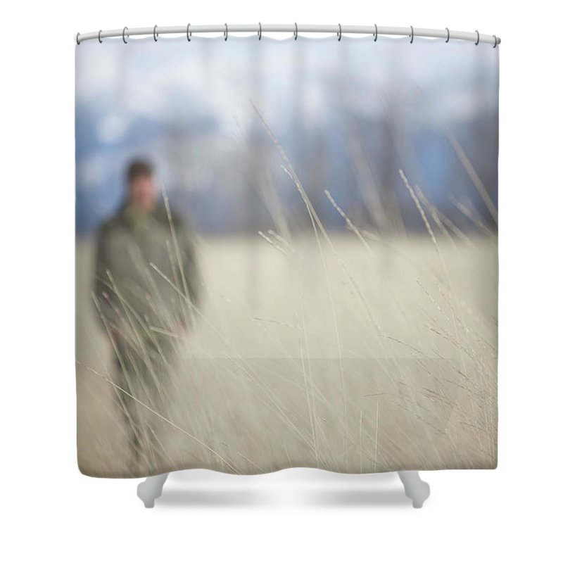 Adult Shower Curtain featuring the photograph A Young Man Enjoys A Winter Stroll by Heath Korvola