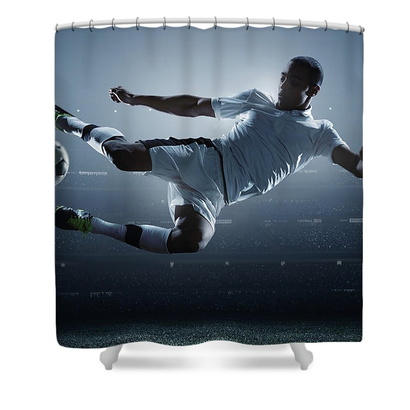 Goal Shower Curtain featuring the photograph Soccer Player Kicking Ball In Stadium by Dmytro Aksonov