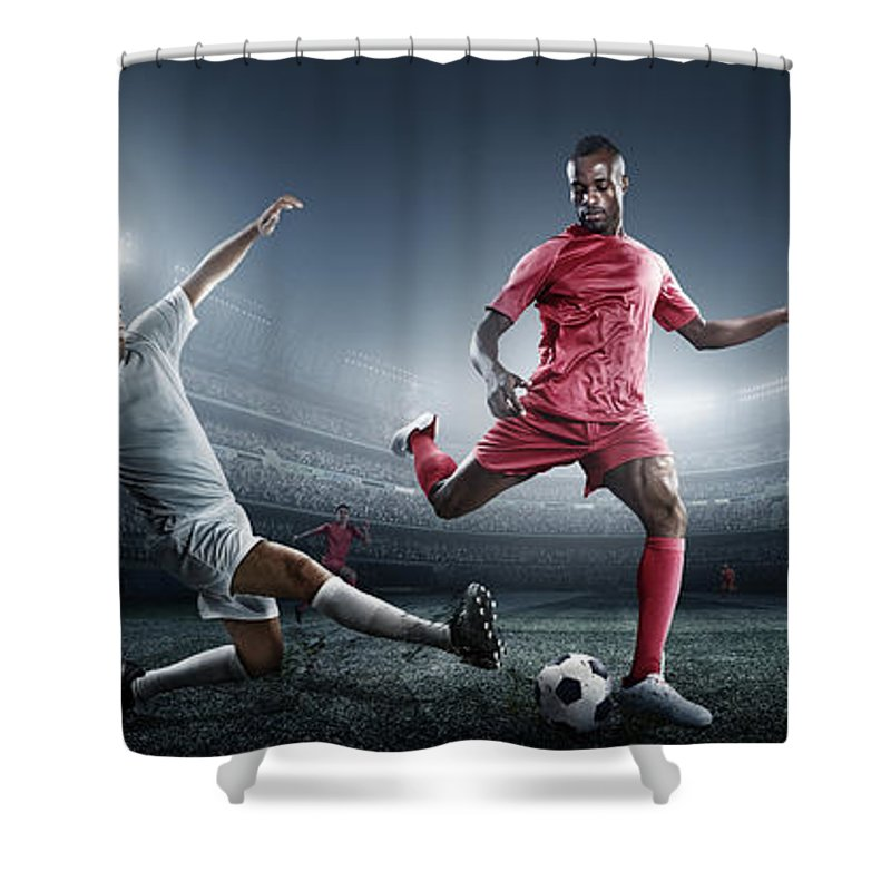 Soccer Uniform Shower Curtain featuring the photograph Soccer Player Kicking Ball In Stadium by Dmytro Aksonov