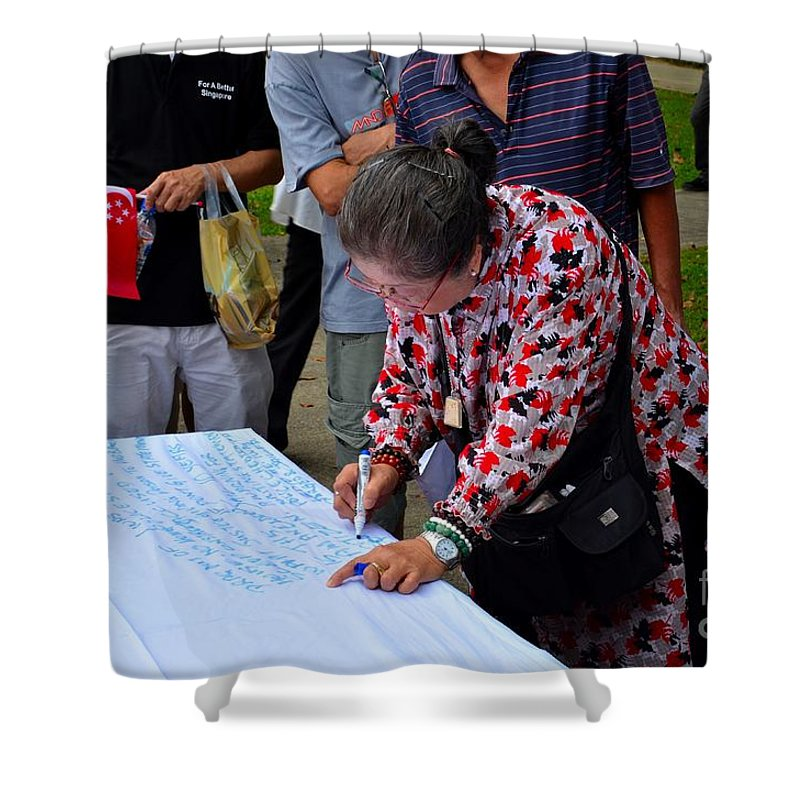 Lady Shower Curtain featuring the photograph A Lady Signs Petition At May Day Rally Singapore by Imran Ahmed