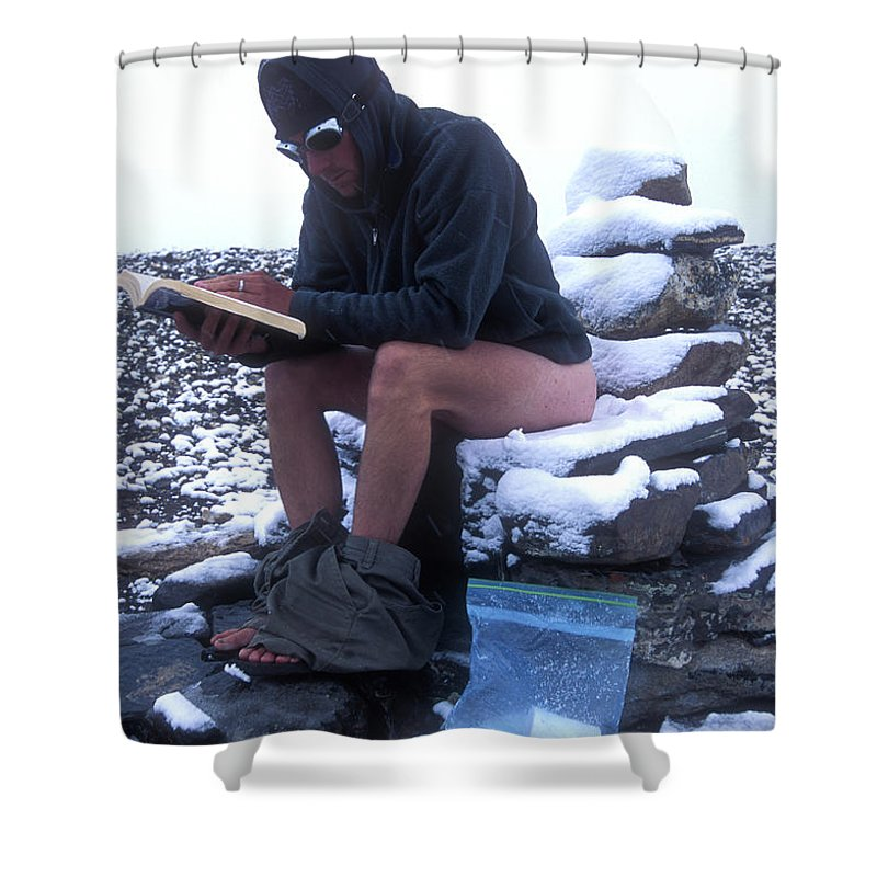 Adventure Shower Curtain featuring the photograph A Man Reads While Using A Snow-covered by Jimmy Chin
