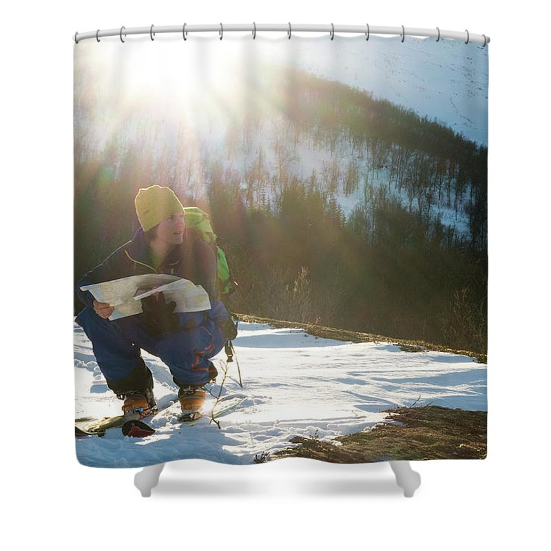 20s Shower Curtain featuring the photograph A Norwegian Skier Examines A Map by Kari Medig