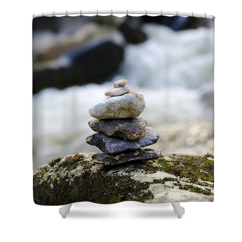 A Shower Curtain featuring the photograph A Pile Of Stones by Bill Cannon