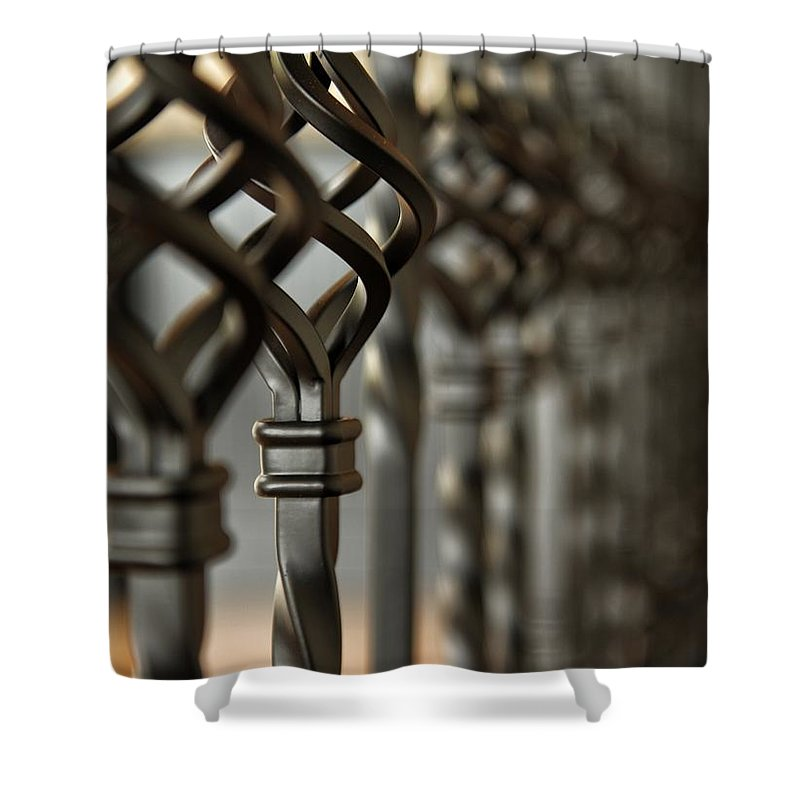 Black Shower Curtain featuring the photograph A Row Of Spindle's by Seth Solesbee