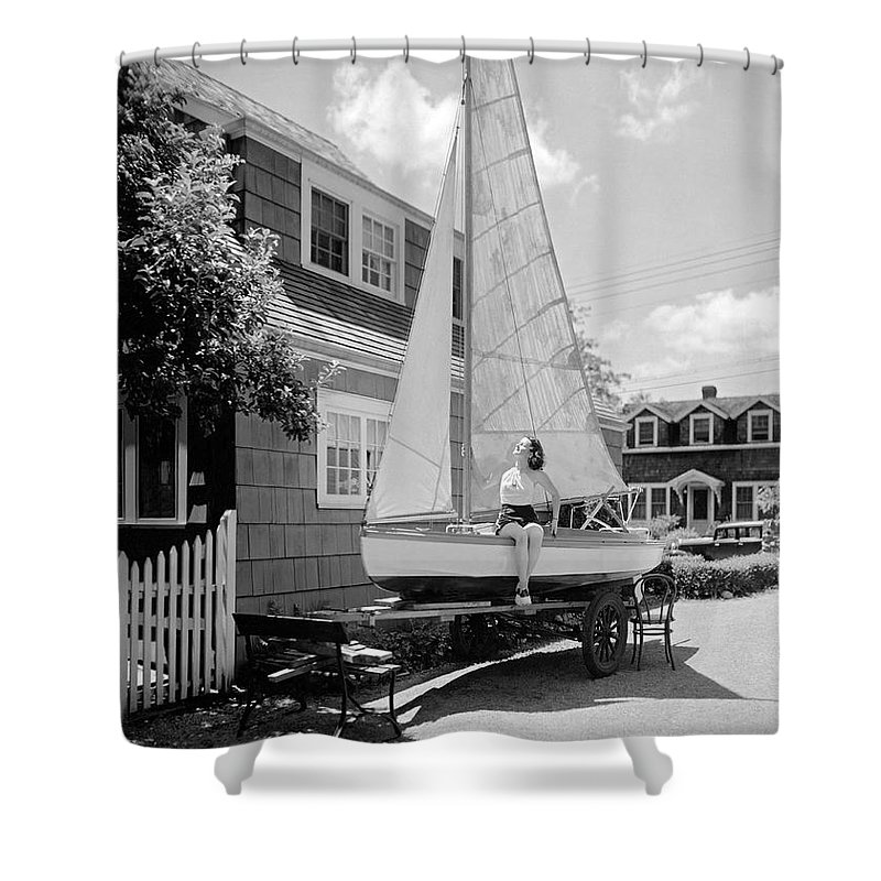 1933 Shower Curtain featuring the photograph A Woman On Sailboat At Home by Underwood Archives