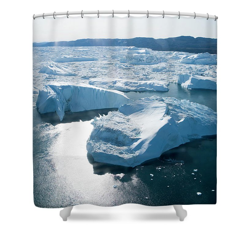 Melting Shower Curtain featuring the photograph Aerial Of Icebergs Of Ilulissat by Holger Leue