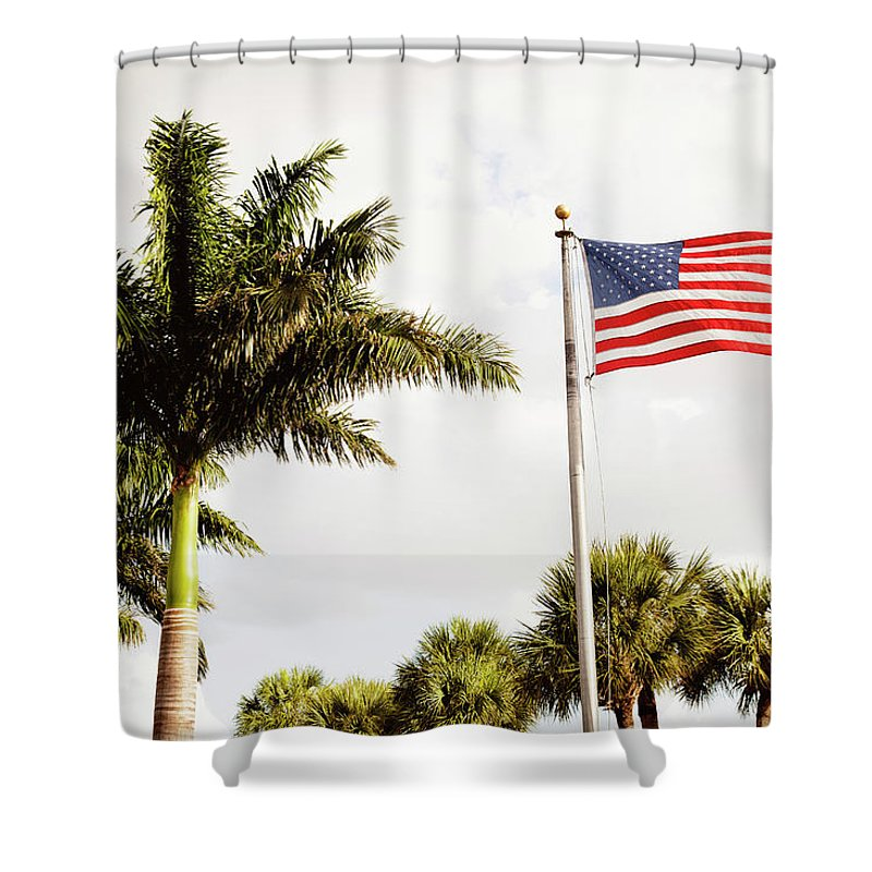 Tranquility Shower Curtain featuring the photograph American Flag Flying Amongst Palm Trees by Ron Levine