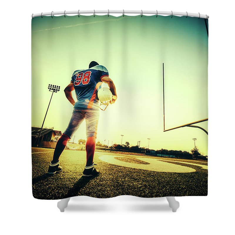 Headwear Shower Curtain featuring the photograph American Football Player by Ferrantraite